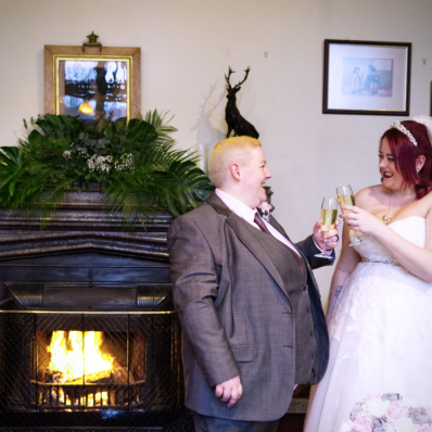 Two brides smiling with glasses of prosecco at the sessions house in Spalding