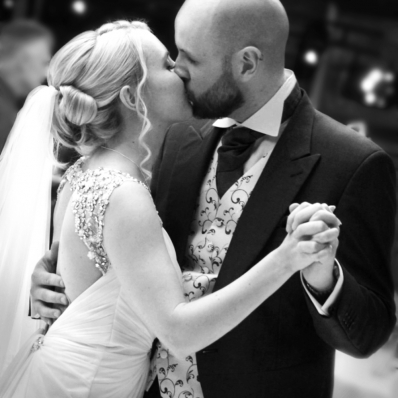 Bride and Groom kiss during first dance at Castle Bromwich Hall in Birmingham