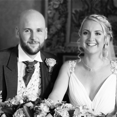 Bride and groom signing register at wedding at castle bromwich hall