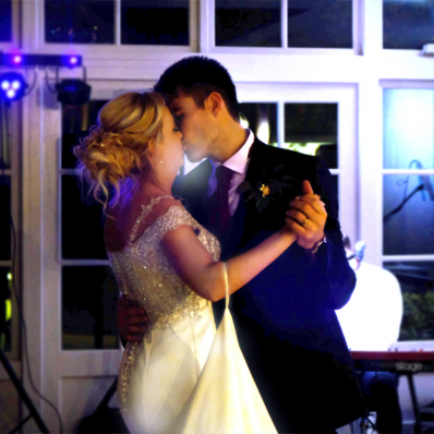 couple kiss during first dance at their wedding at Lemore Manor