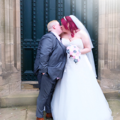 two brides kissing on their wedding day
