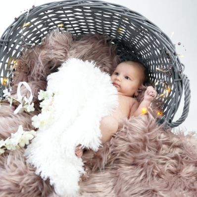 cute baby photoshoot in a basket