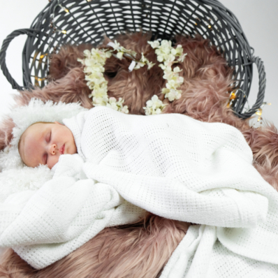 sleeping baby wrapped in a blanket