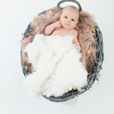 Cute baby in basket in the studio