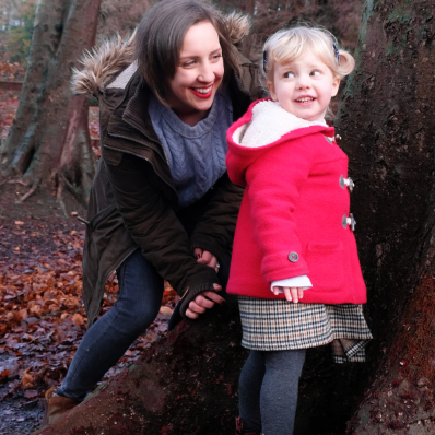 mother and daughter playing hide and seek in the lickey hills worcestershire