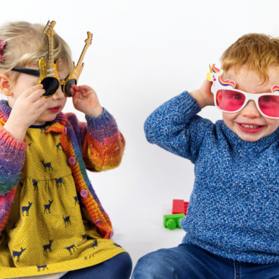 little boy and girl wearing novelty sunglasses