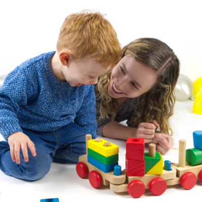 Mother and Son playing with a train