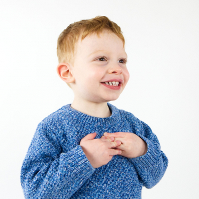 little boy smiling in the studio photoshoot