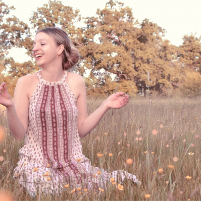 Girl in a field playing with the daisies in redditch worcestershire