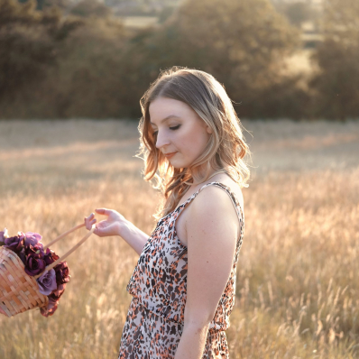 Girl with a flower basket in a sunset field in Redditch Worcestershire