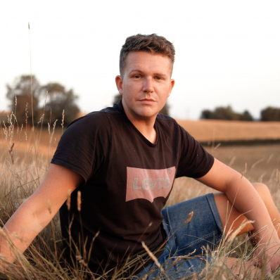boy posing in a sunset field during golden hour in redditch worcestershire