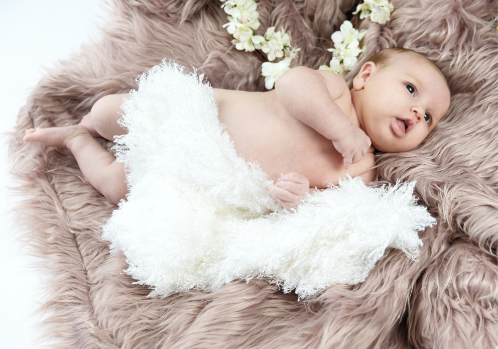 baby on a fluffy rug photoshoot in studio redditch