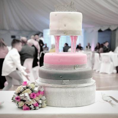 delicious pink white and grey wedding cake diamante