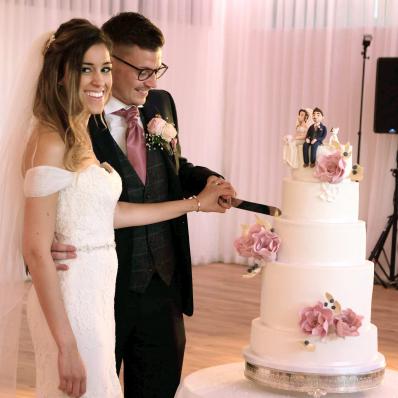 bridge and groom cutting of the wedding cake evesham worcestershire