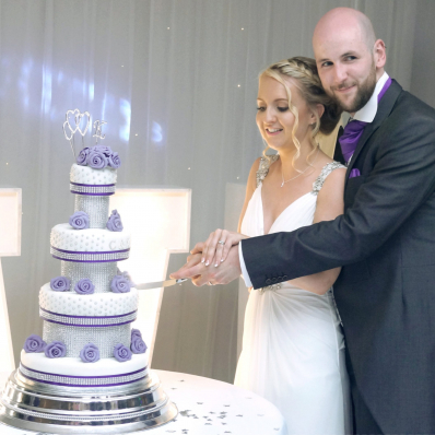 Bride and groom cutting wedding cake castle bromwich hall