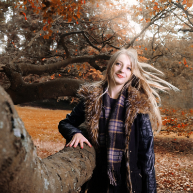 Girl in a sunny autumn forest lickey hills birmingham