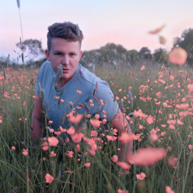 boy posing in a buttercup field in redditch worcestershire