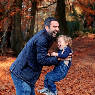 father and son laughing autumn photoshoot lickey hills birmingham