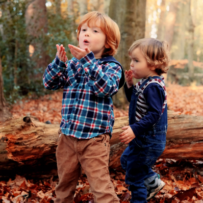 little brothers blowing kisses autumn photoshoot lickey hills birmingham