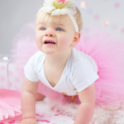girl first birthday photoshoot pink