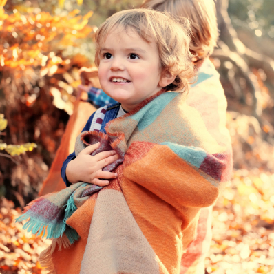little brother wrapped in blanket autumn photoshoot lickey hills birmingham