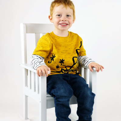 little boy sat in a chair studio photoshoot worcestershire