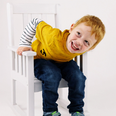 little boy sat in chair studio photoshoot worcestershire