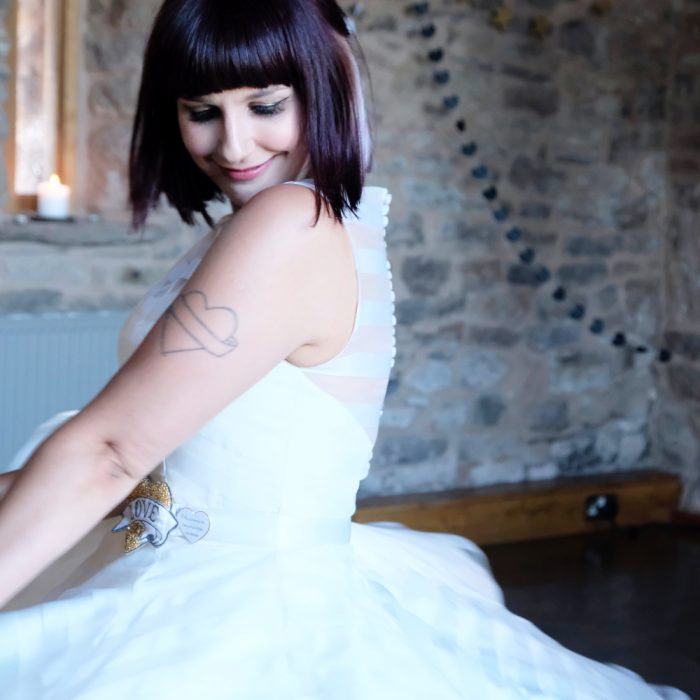 Beautiful rock and roll bride smiling during first dance in Lyde Arundel in Hereford